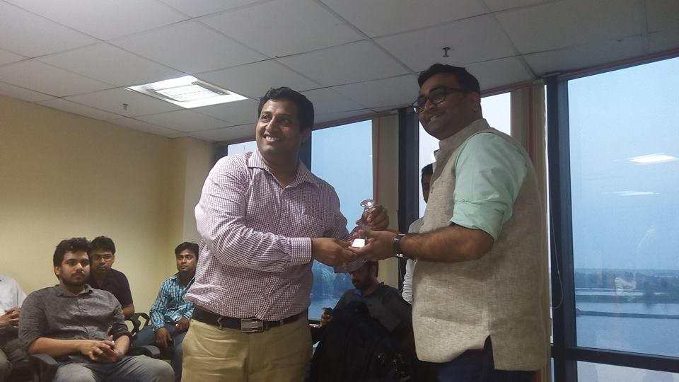 Mr. Vikas Malpani is receiving a memento from Mr. Abhishek Rungta